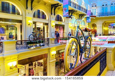 MOSCOW RUSSIA - MAY 10 2015: The interior of GUM (State Department Store) decorated with retro cycles nowadays popular in Moscow on May 10 in Moscow.