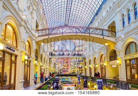 MOSCOW RUSSIA - MAY 10 2015: Interior of one of the most expensive and splendid shopping centers in Moscow - GUM (State Department Store) on May 10 in Moscow.