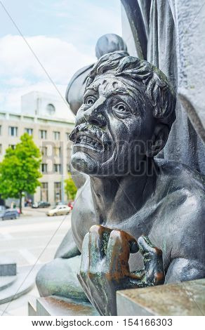KHARKOV UKRAINE - MAY 20 2016: The sculptures of dying Gaydamak (poem character) with the agony on his face at the foot of Taras Shevchenko Monument in Kharkov on May 20 in Kharkov.