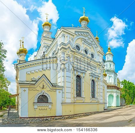 The yellow building of the Church of Holy Virgin Lady of Ozeriana is the part of Holy Virgin Monastery Kharkov Ukraine.