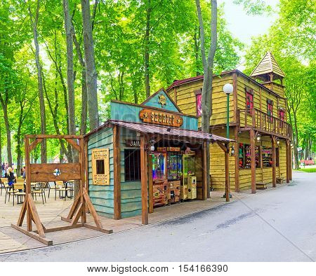 KHARKOV UKRAINE - MAY 20 2016: The stalls and cafes in Western style town in Gorky Park decorated as saloon Sheriff's Office and Jail on May 20 in Kharkov.