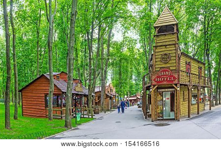 KHARKOV UKRAINE - MAY 20 2016: The Western style town in Gorky Park is famous among local children enjoying active games and funny attractions here on May 20 in Kharkov.