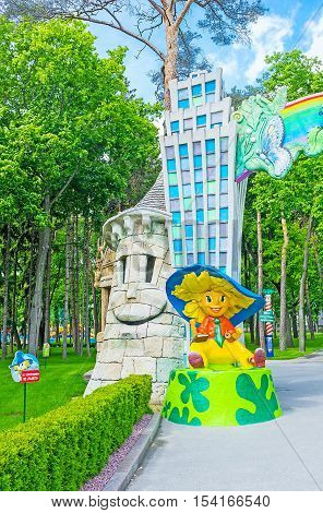 KHARKOV UKRAINE - MAY 20 2016: The entrance gate to the children's amusement park with the sculpture of Dunno (Neznayka) famous character of Nikolay Nosov's story Gorky Park on May 20 in Kharkov.