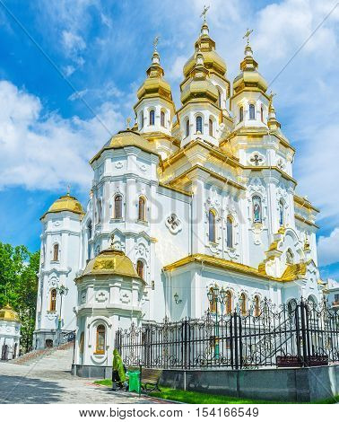 The Church of the Holy Myrrh-Bearers in Victory Square boasts bright golden domes and relief decors Kharkov Ukraine.