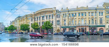 KHARKOV UKRAINE - MAY 20 2016: The historic mansions in the Konstitutsii Square with the Puppet Theater building decorated with mosaic pictures on May 20 in Kharkov.