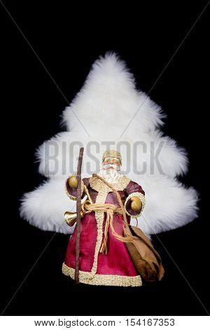 Santa Claus figurine white christmas tree isolated on black background