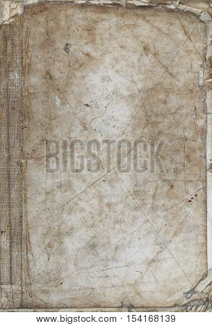 Detail of the old tattered book on white background