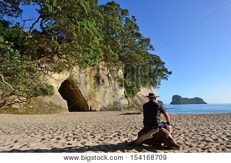 Mature man visit in Te Whanganui-A-Hei (Cathedral Cove) Marine Reserve in Coromandel Peninsula North Island New Zealand.