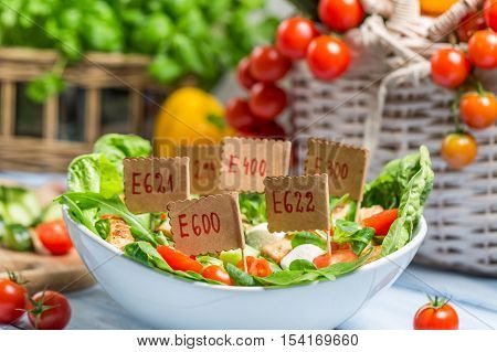 Nice looking food can have preservatives on old wooden table