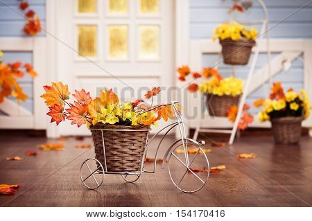 Decorative Bicycle With Basket With Yellow  Leaves And Autumn Grapes Berries On The Wooden Floor. Ho