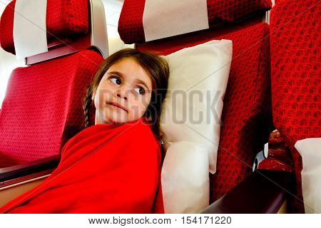 Little Girl In A Plane Scared To Fly -  Flying Phobia
