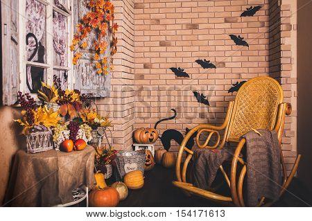 Halloween autumn patio. Brick wall with retro window