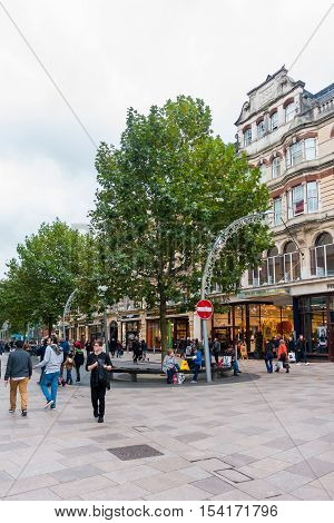 Cardiff Wales United Kingdom - October 27 2016: Locals and tourists shopping in The Hayes Cardiff one of the most scenic and historic shopping streets on an overcast autumn day.