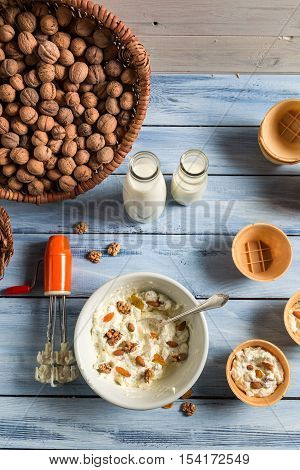 Preparing homemade nuts ice cream on old wooden table