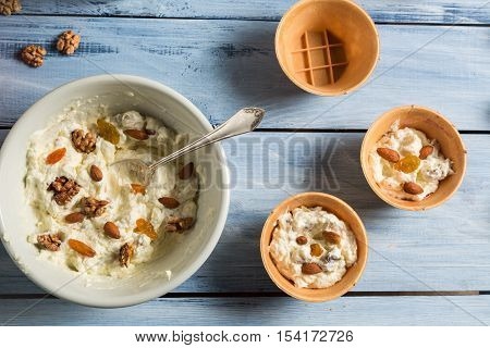 Yogurt Mixed With Nuts, Almonds And Raisins As Ice Cream