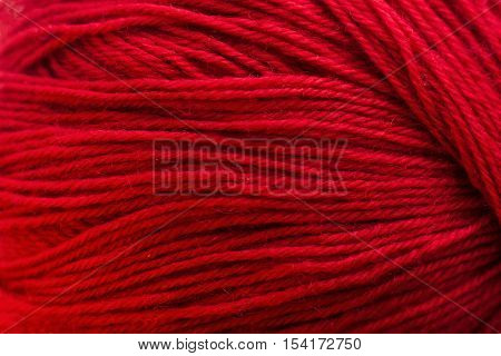 Red knitting thread texture, handiwork backdrop. Bright handiwork background, crochet woolen string, Leisure, hobby, needlework concept
