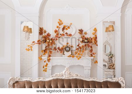 Yellow Leaves Entwined Wall Of White Hall With Fireplace