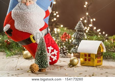 christmas decorations with big christmas stockings and small toy house.