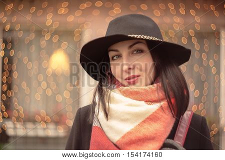 woman with ironic smile on blurred lights background