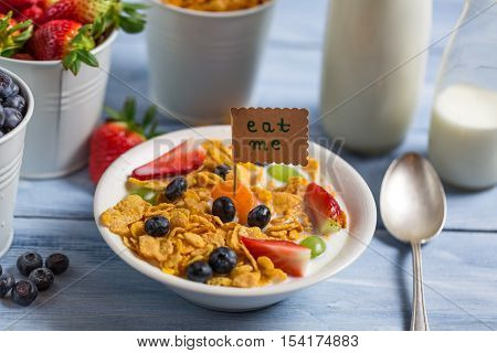 Enjoy your healthy breakfast with fruits on old wooden table