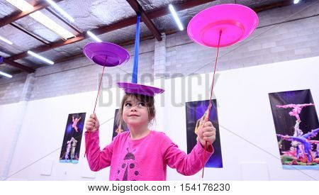 Little Child Learn Circus Skills Of Plate Spinning
