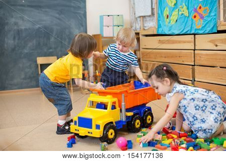 two kids conflict for toy truck in kindergarten