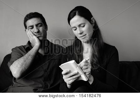 Worried Couple Listing Expenses