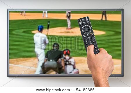 Man Is Watching Baseball Match On Tv