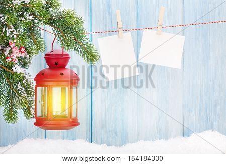 Christmas candle lantern and blank photo frames