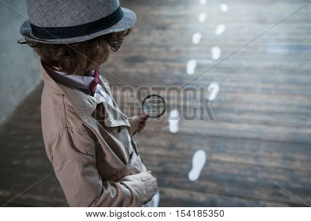Detective with a magnifying glass