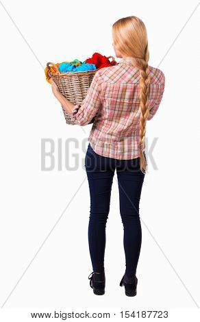 Back view woman with  basket of dirty laundry. girl is engaged in washing. Rear view people collection.  backside view person. Isolated over white background. Girl with very long hair holding basket