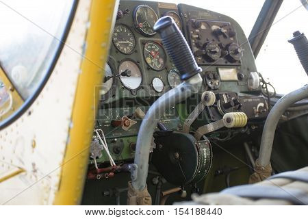 Small private motor airplane dashboard inside the cabin.