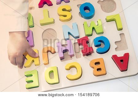 Hand Of Active Kid Boy Having Fun With Wooden Letters