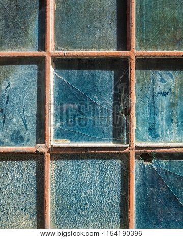 Old window with broken glass as background or frame