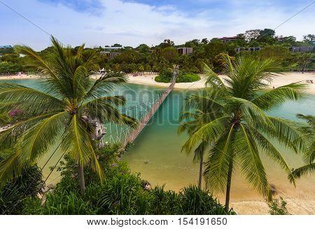 Hanging bridge to Palawan island in Sentosa Singapore - travel background
