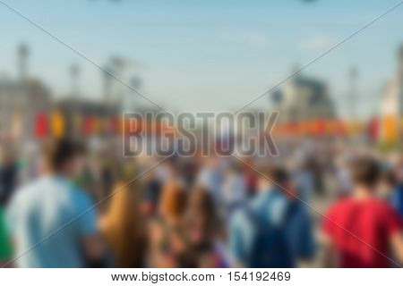 Large crowd parade theme creative abstract blur background with bokeh effect poster