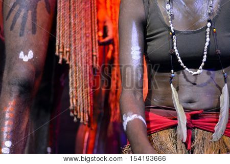 Yirrganydji Aboriginal woman and man during cultural show in Queensland Australia.
