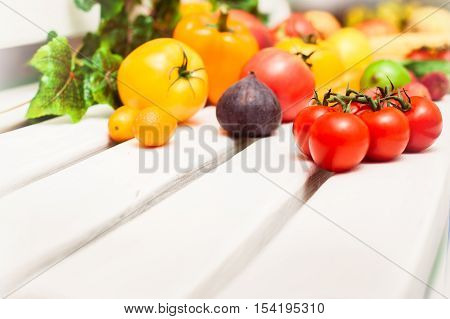 Different Fruits And Vegetables Scattered On The White Bench Ent
