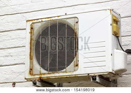 Rusting Metal Exterior Fitted Airconditioning Unit Mounted On Wall