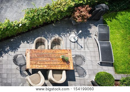 Sunny patio with table and chairs high angle view