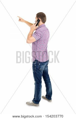 Back view of pointing young men talking on phone. Backside view of person. Rear view people collection. Isolated over white background.