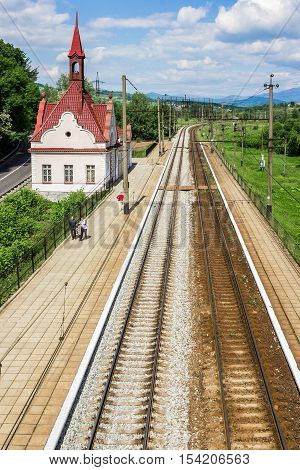 Karpaty Ukraine - May 20 2016: Karpaty railway station - a train stop point near the famous Schonborn Castle former residence and hunting lodge of Count Schonborn and since 1946 - sanatorium