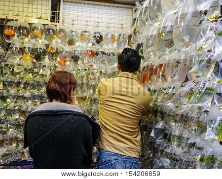 Customers Visiting Fish Shop