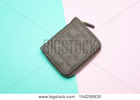 Close-up of a small woman's purse on a colored background