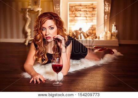 Redhead Girl Relaxing With Glass Of Red Wine