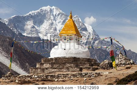 Stupa near Dingboche village with prayer flags and mounts Kangtega and Thamserku - way to mount Everest base camp - Khumbu valley - Nepal