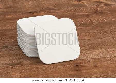 White paper coasters. Isolated on wood background. 3d render