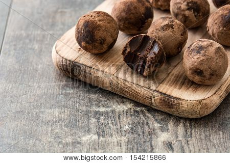 Delicious homemade chocolate truffles on wooden table