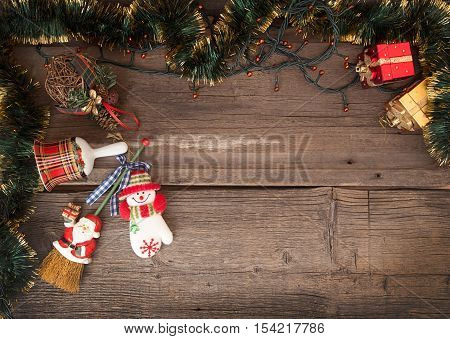 Christmas Old Wooden Background With Garland And Christmas Decorations