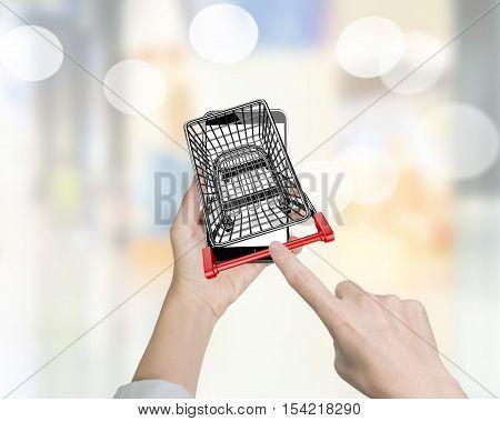 Woman Forefinger Pushing Shopping Cart On Smartphone